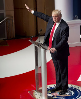 Trump waves, photo maliciously implying a nazi salute